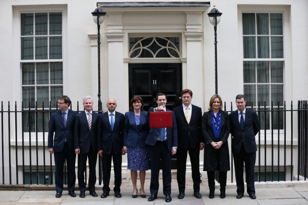 Chancellor George Osborne and his Treasury team outside Number 11 Downing Street before he delivered his fifth Budget today